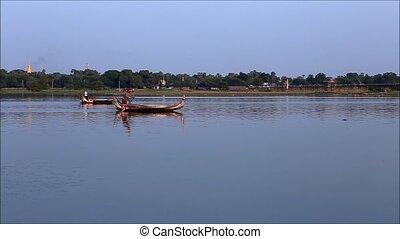 myanmar - MANDALAY, MYANMAR-DEC 8; A boatman finding ...