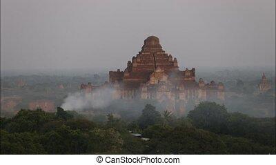 Old pagoda of Bagan with smoke in evening , Bagan Myanmar