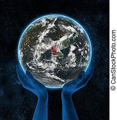 Myanmar on night planet Earth in hands