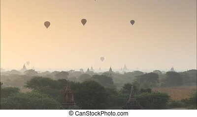 myanmar - Scenic sunrise old pagoda with balloon at Bagan...