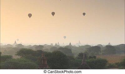 Scenic sunrise old pagoda with balloon at Bagan Myanmar