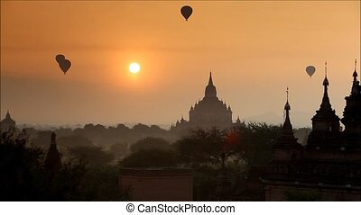 myanmar - Scenic sunrise with balloon above old pagodas at...