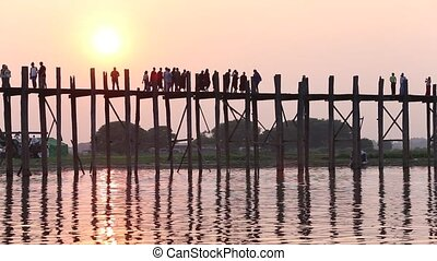 myanmar - Silhouette life of Ubein Bridge at sunrise,...