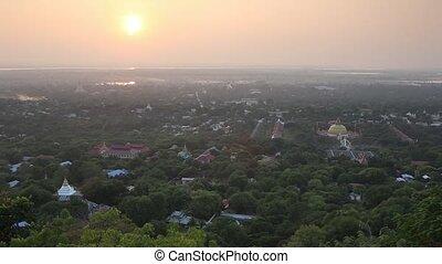 Sunset with sunlight above Mandalay City Myanmar