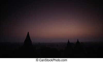 Time lapse scenic sunrise old pagoda with balloon at Bagan Myanmar