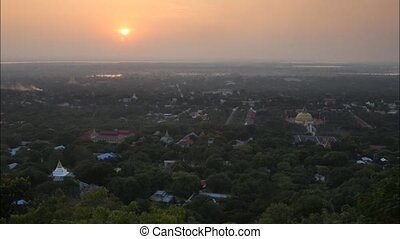 myanmaR - Time lapse sunset view from sky palace Mandalay...
