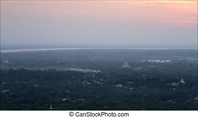 myanmar - View of sunset and Mandalay city form sky palace...