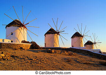 Mykonos sunset - Traditional Greek windmills at sunset,...