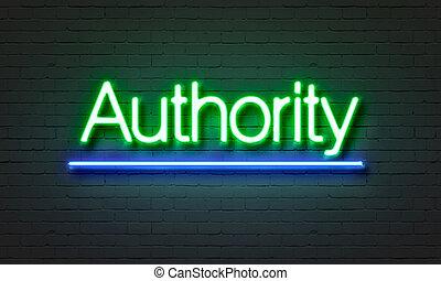 myndighet, neon signera, på, tegelsten vägg, bakgrund.