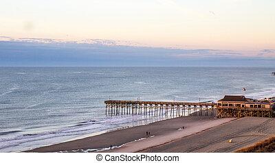 Pier and Atlantic Ocean coast in Myrtle Beach, South Carolina.