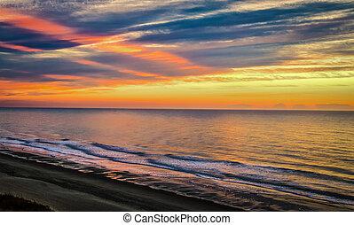 The sunrise over the Atlantic Ocean horizon. Myrtle Beach, South Carolina.