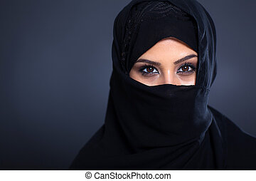 mysterious Arabian woman on black background
