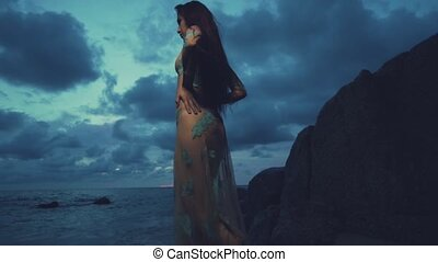 Mysterious beauty at the beach during sunset - Beautiful...
