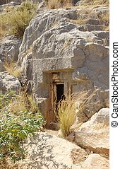 Mysterious cave entrance - entrance to entombment in ancient...