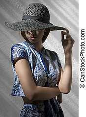 mysterious fashion girl with hat