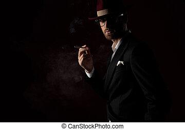 Mysterious fashion model smoking a cigarette