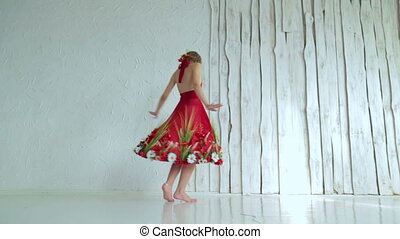 Mysterious girl with creative make-up in ethnic red dress spinning around
