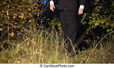 Mysterious headless figure in a business suit with a...