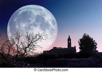Mysterious landscape with full moon and church