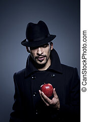 Mysterious man holding an apple
