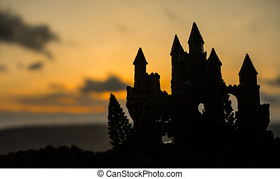 Mysterious medieval castle at sunset. Abandoned gothic style old castle at the evening.
