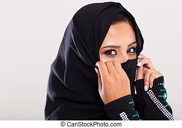 mysterious middle eastern woman closeup portrait