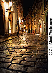 narrow alley with lanterns in Prague at night - mysterious ...