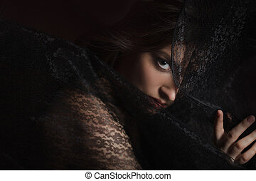 Mysterious portrait of beautiful woman in black lace veil -...