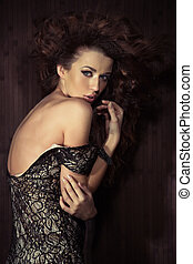 Mysterious pose of an attractive lady - Mysterious pose of...