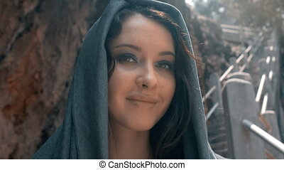 Mysterious sexy woman with make up in grey hood