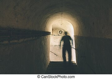 Mysterious underground - Man is walking through dark ...