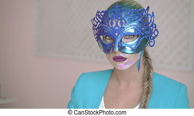Mysterious woman dressed in venetian masquerade carnival mask at party 4K
