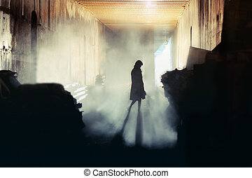 Mysterious Woman - A lone wonan stands in a misty...