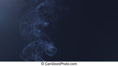 mystery blue smoke over dark background with copy space