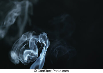 mystery dense blue smoke over dark background