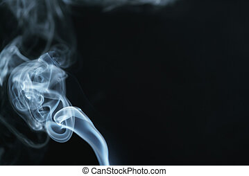 mystery light blue smoke over dark background with copy space