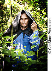 mystery man with medieval sword - Fantasy foto of handsome...