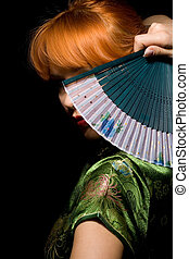 mystery - redhead girl in chinese dress playing with fan