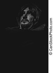 Mystery, vampire man with great contrasts of light, large black cloak