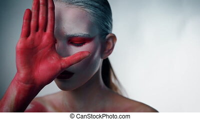 Mystery weird girl closed her face with bloody hand and...