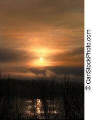 Mystic fog at sunset - Cold landscape with frozen river,...