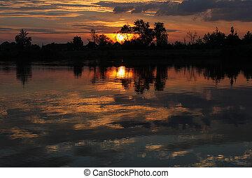 mystic summer sunset over lake