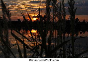 mystic sunset over lake