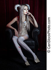 Mystic woman dreams. - Mystic woman with horns sitting in a...