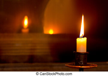 mystical flaming candle - a flaming candle in the dark room