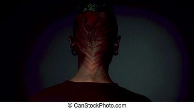 Mystical monster makeup and hair for Halloween. Man with...