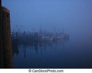 Mystical Port - Fog envelops all during a still evening at...