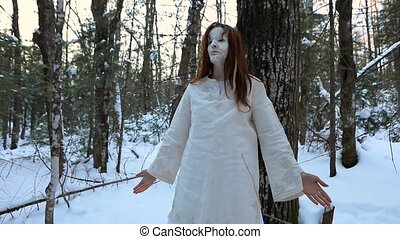 A magical native oracle is seen standing in a winter forest, with hands by side, opening eyes during shamanic meditation, seeking guidance from spirit