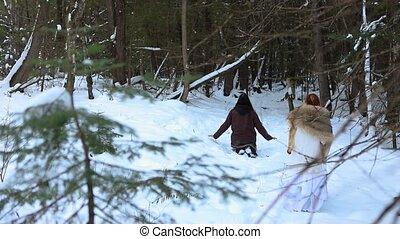 Mystical shaman healer in winter forest - Slow motion ...