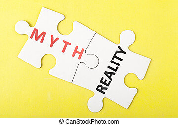 Myth and reality words on two pieces of puzzle